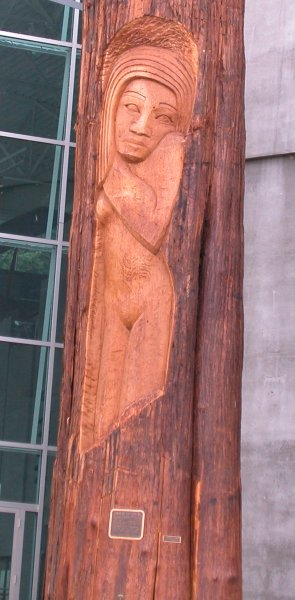 Finely carved cedar poles